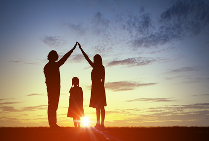 Silhouettes of happy family of three people mother father and child